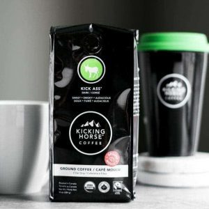 Kicking Horse Coffee bag with mug and cup behind it.