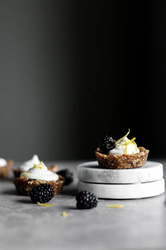 Mini Sugar-Free Cookie Dough Cheesecake as seen from the side with blackberries