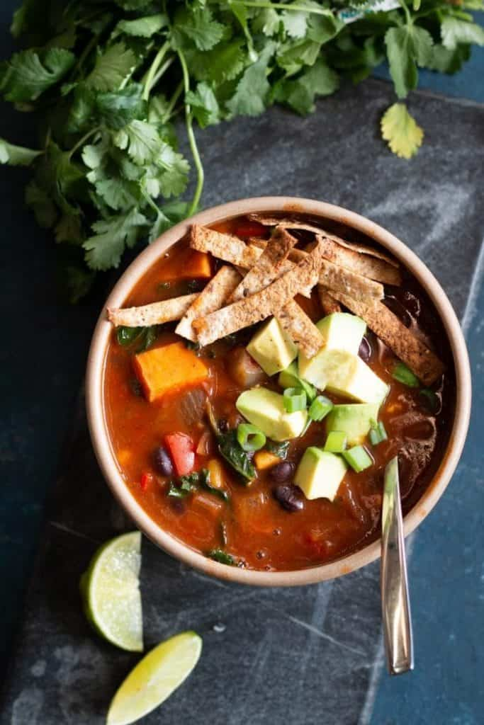 enchilada soup in bowl with cilantro