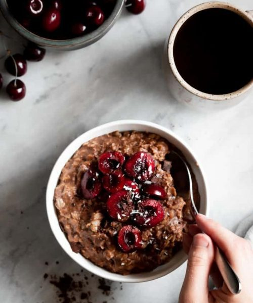 chocolate oatmeal in bowl with cherries