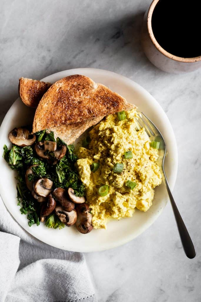 tofu scramble with vegetables and toast on a plate