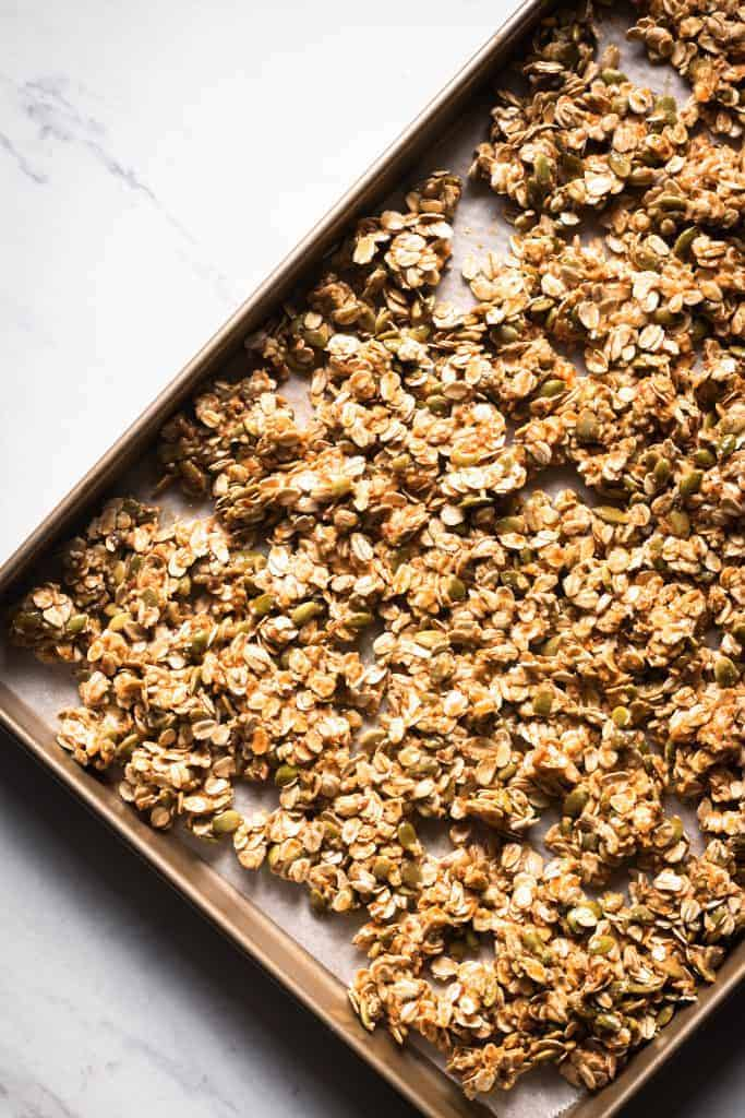 granola mixture on a baking sheet