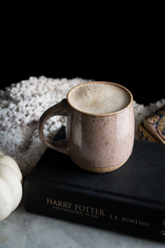 latte in a mug on a book
