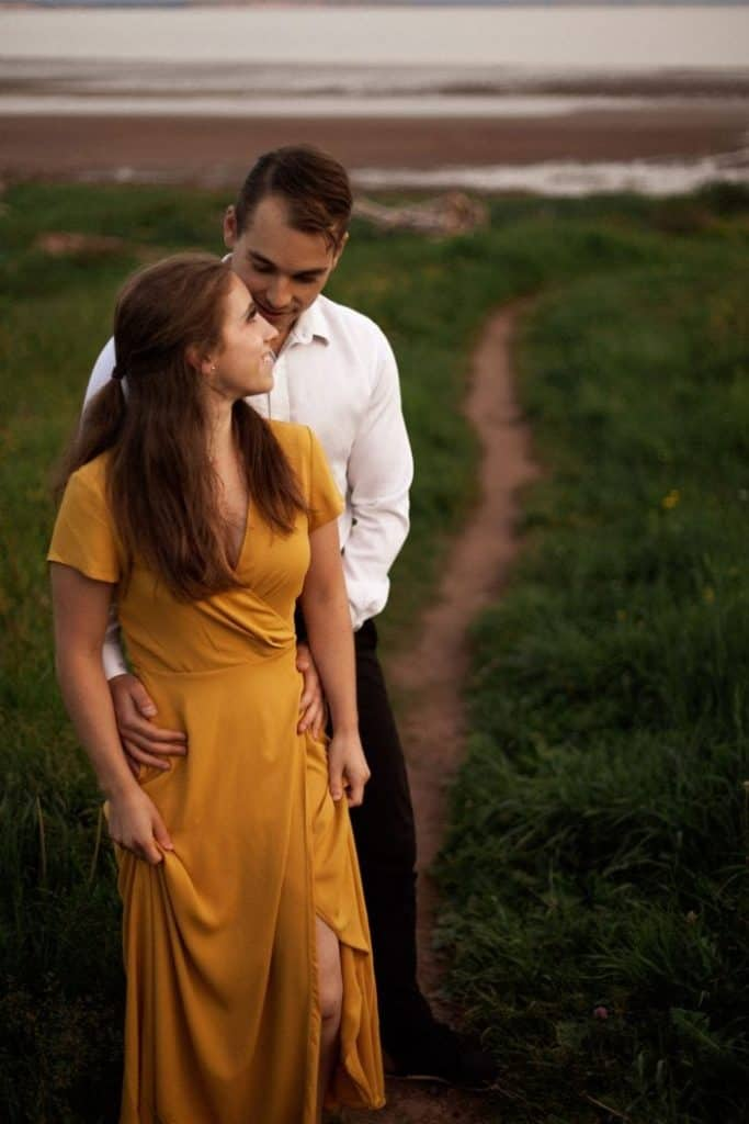couple standing in the grass
