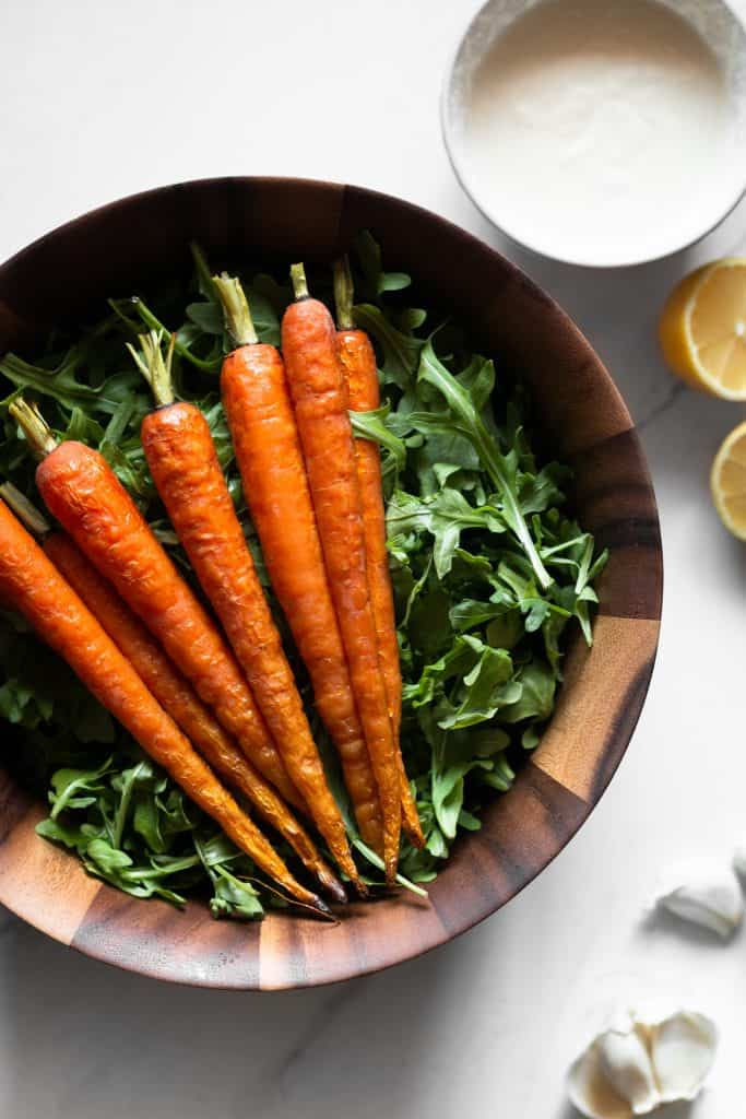 arugula and roasted carrots in a bowl