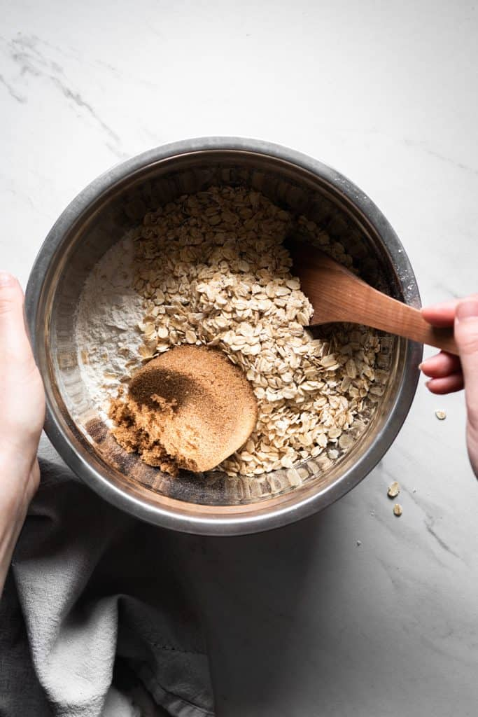 oats, flour and sugar in a mixing bowl