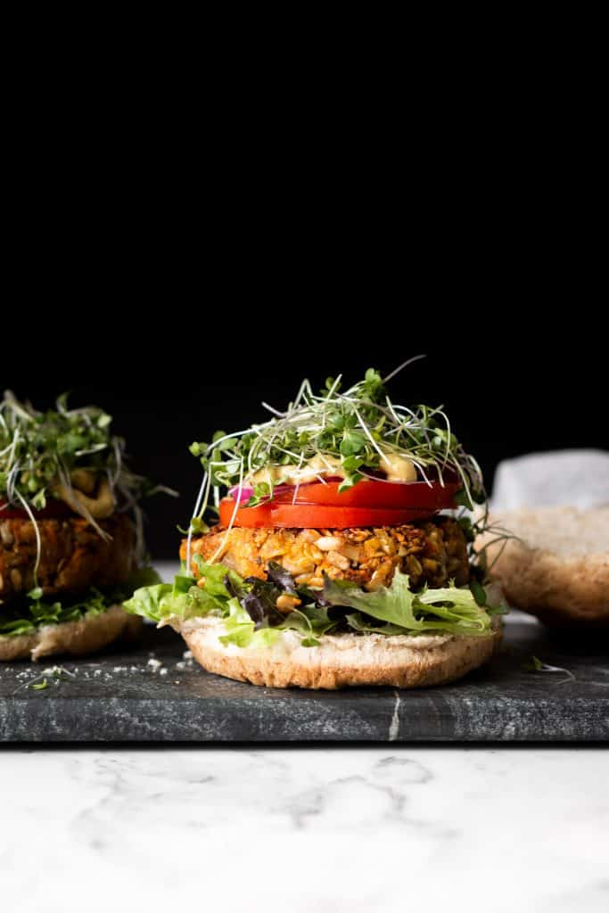 chickpea burger with toppings, from the side
