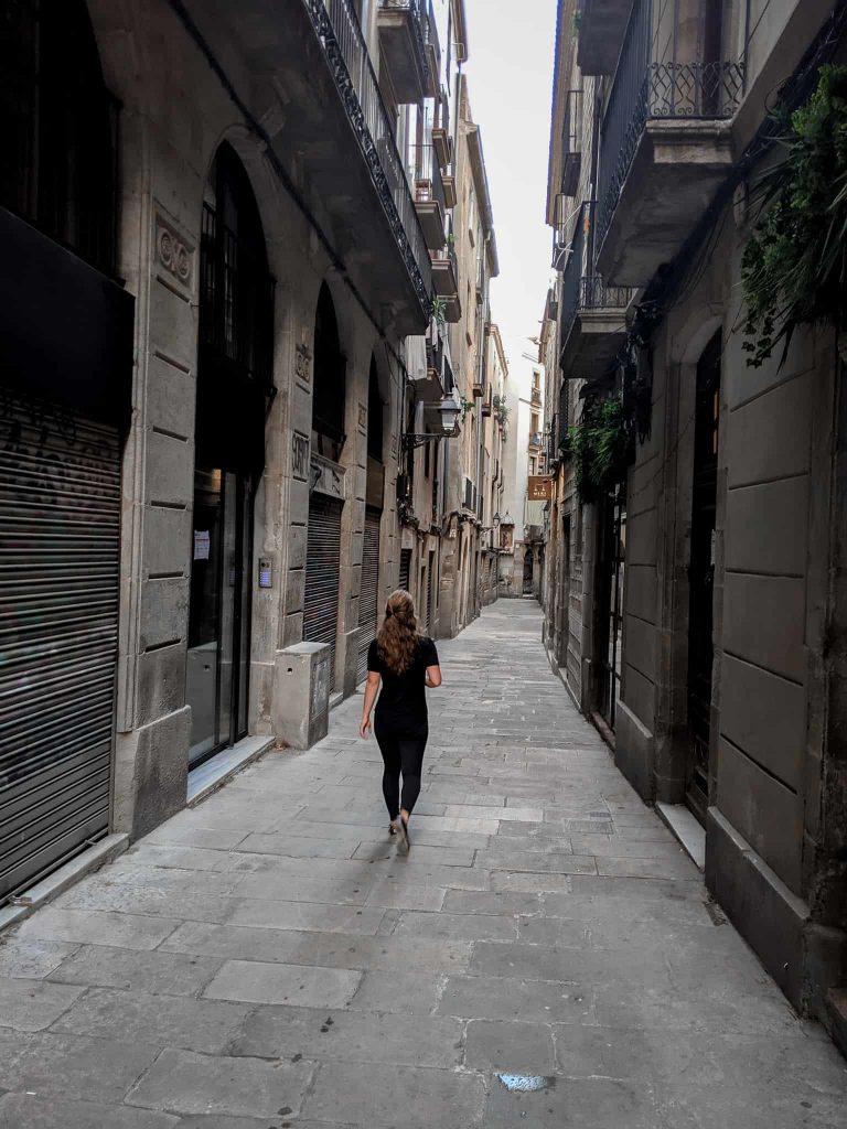 Girl walking in empty street