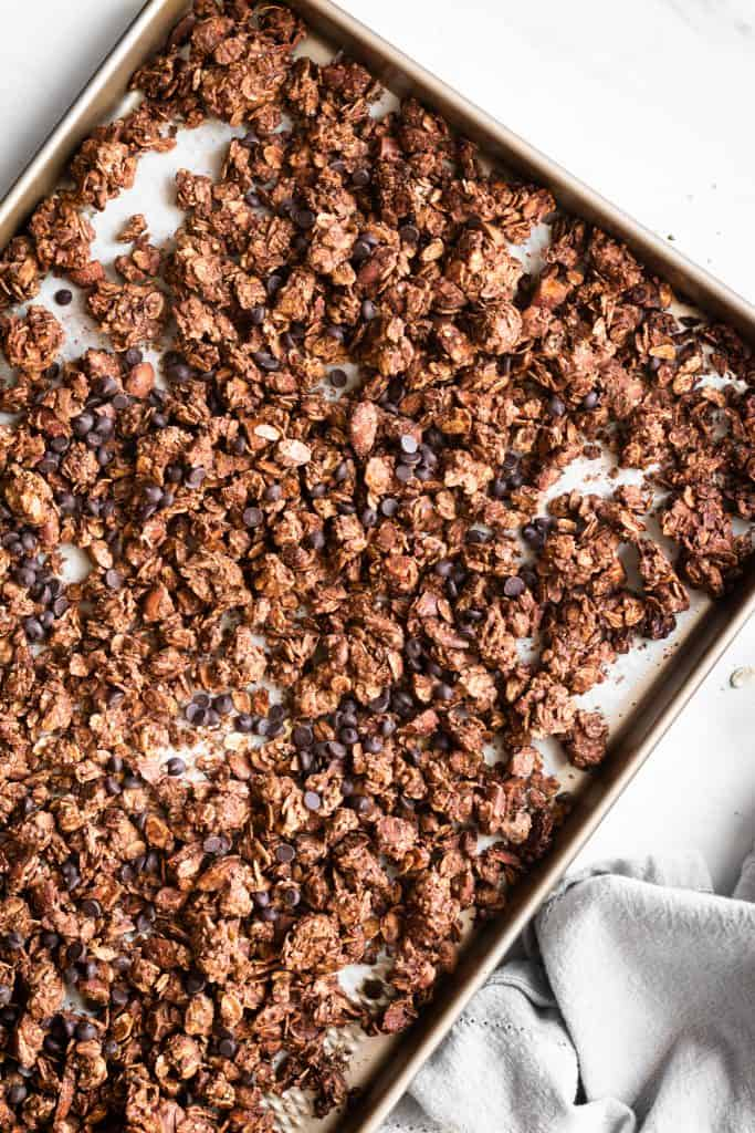 chocolate almond granola on a baking sheet from the top