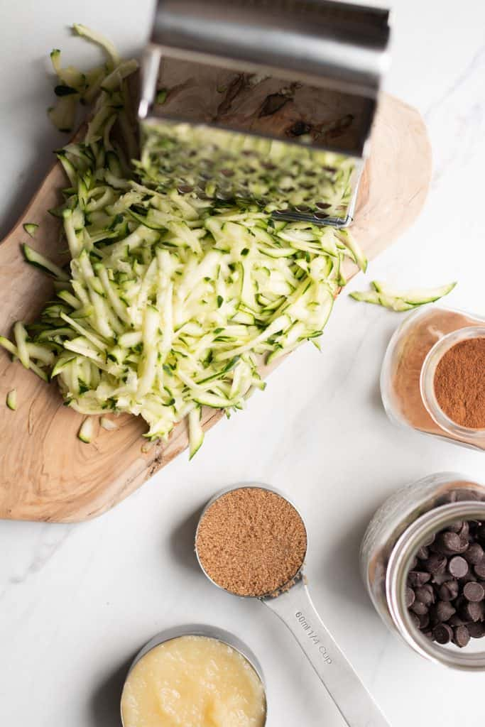 shredded zucchini, grater, sugar, cinnamon, applesauce and chocolate from the top