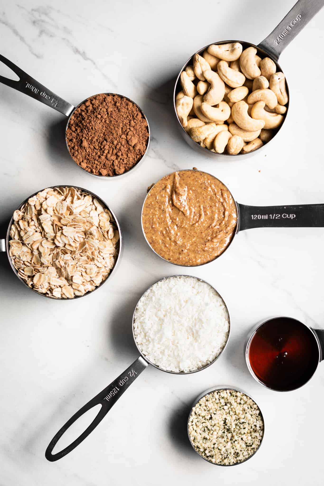 granola ingredients in measuring cups