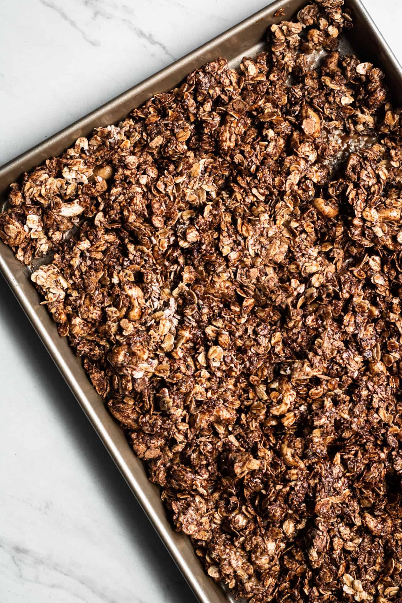 granola mixture unbaked on a baking sheet