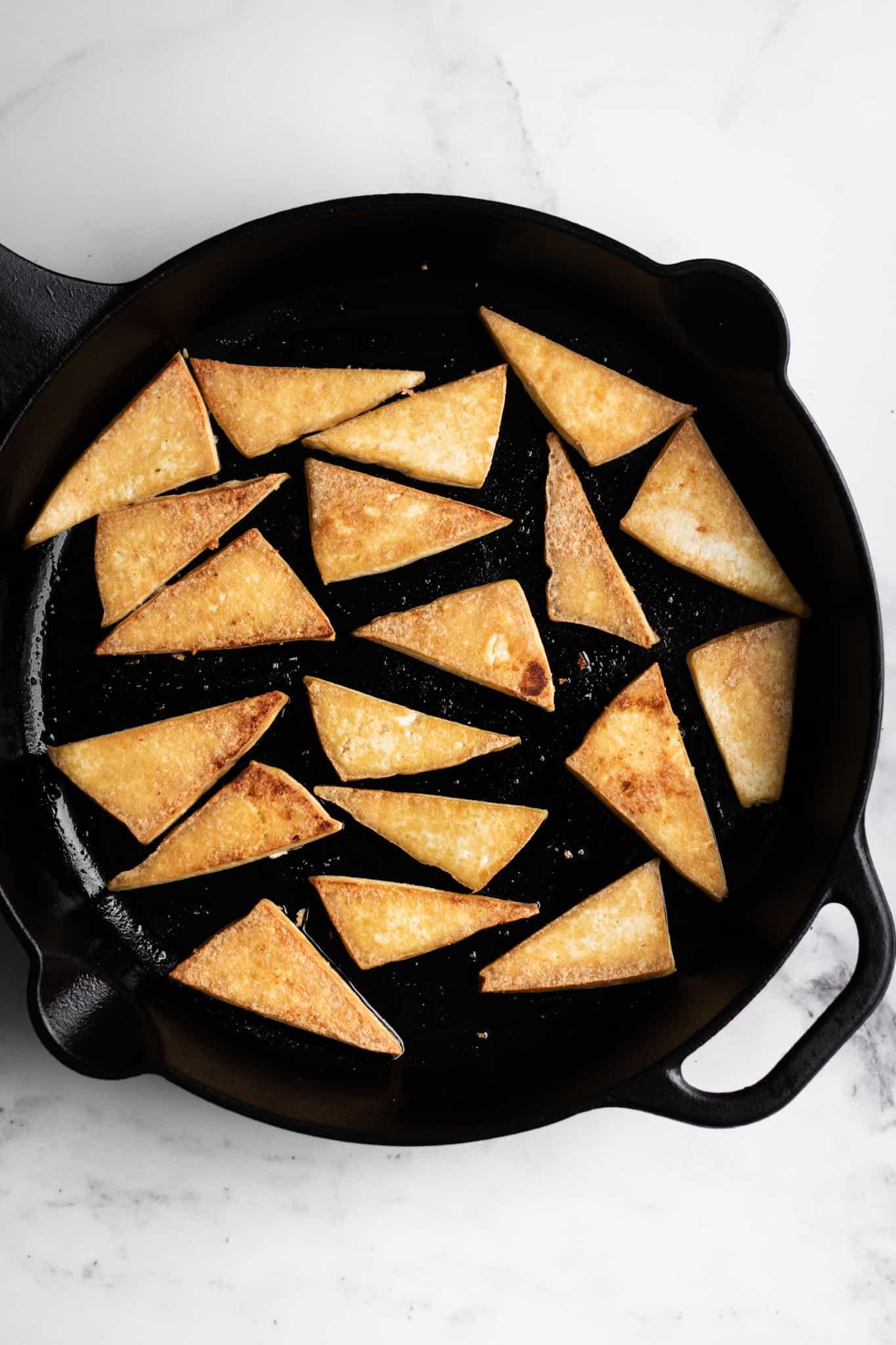 tofu in a cast-iron skillet